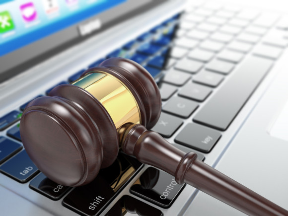 Online auction. Gavel on laptop. - How to buy your first car at auction